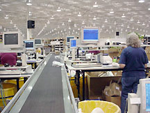 Conveyor line and pack stations in Mouser's receiving area