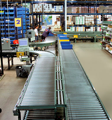 conveyor system for order fulfillment integrated with horizontal carousels