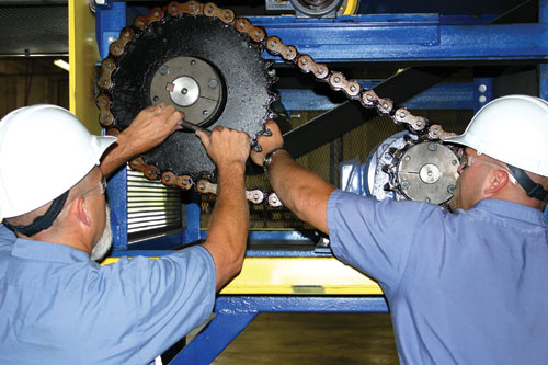 Cisco-Eagle technicians repairing a conveyor