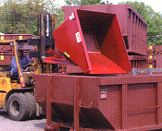 Self-dumping hopper