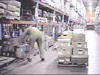 picking from a floor level pallet in a warehouse rack