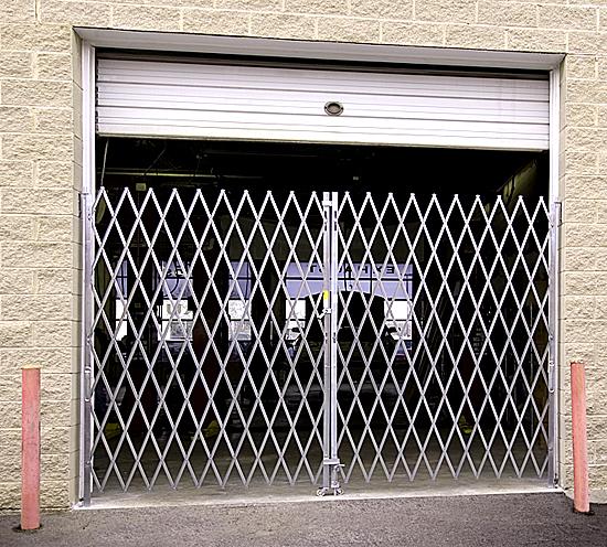 Folding security gate: warehouse dock door application