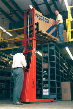 stacker used to elevate pallet to a mezzanine