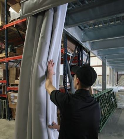 curtain wall being adjusted in a warehouse