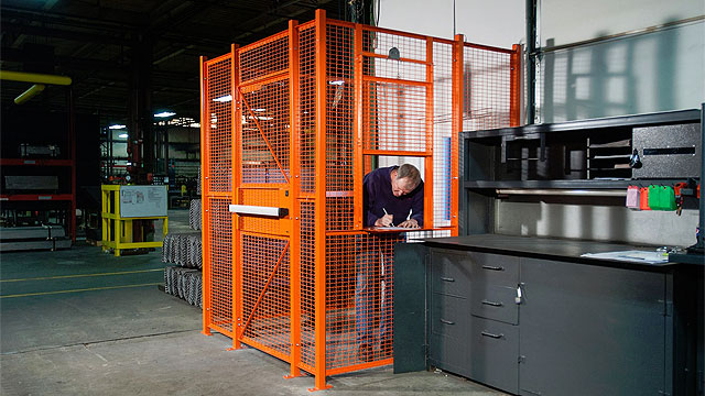 Dock door/driver security cage in a warehouse