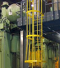 safety guarding on a mezzanine mounted ladder