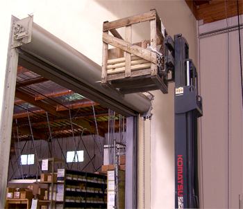 Forklift load about to collide with entry door and wall