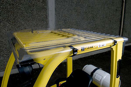 Rigid, long wearing clear forklift cab cover protects operator from falling debris