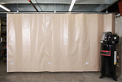 Acoustic curtain fully extended to reduce noise heard in surrounding areas