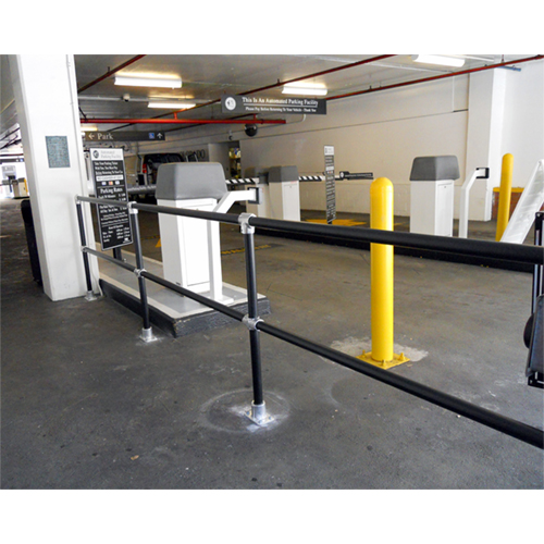 Plastic Sleeved Handrail utilized in a parking garage to protect pedestrians