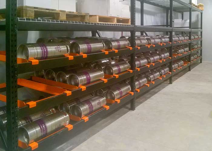 Row of pallet rack outfitted with keg flow accessory.