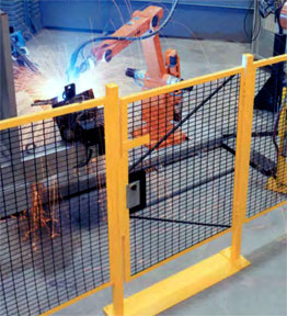 robotic workcell guarded by machine fencing