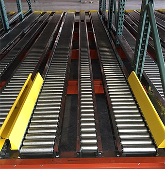 Pallet rack with split rollers installed.