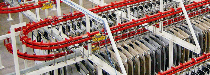 Power and free conveyor used in parts buffer accumulation