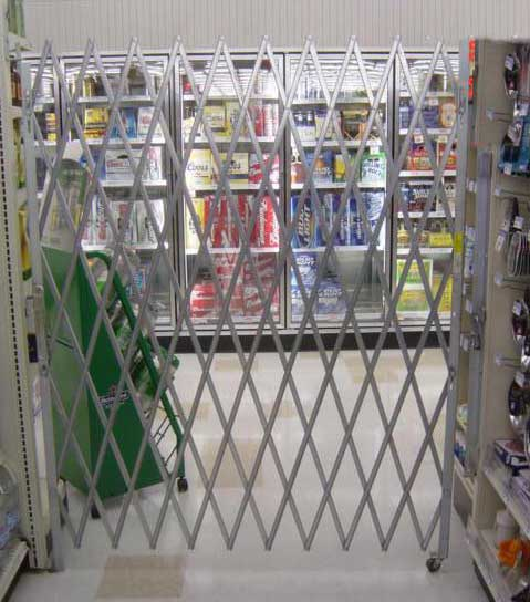 Single gate extended across a retail store aisle.