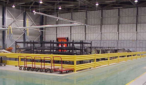 work cell with picking flow rack, protected by guard rails
