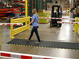 AisleCop® automated warehouse safety gates help manage forklift and pedestrian traffic