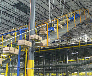 enclosed track conveyor handling cartons and totes