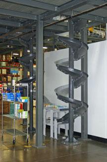 Chute conveyor system feed from mezzanine
