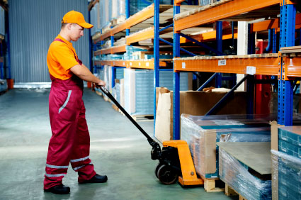 Warehouse worker with pallet rack
