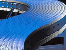 Plastic curve conveyor belt