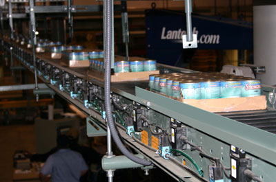 WebLogic conveying wrapped cases of cans