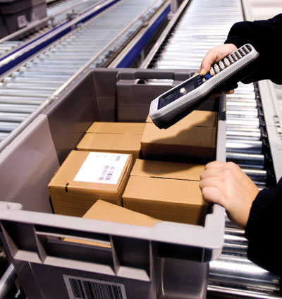 barcode scanning on a conveyed tote